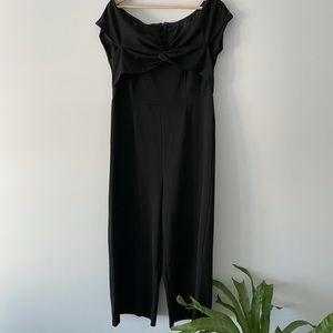 Black off shoulder jumpsuit.